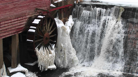 A close-up of water flowing past a gristmill whose... Stock Video Footage