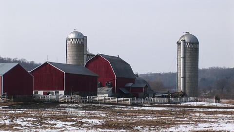 Long shot of well-kept classic American farm buildings in... Stock Video Footage