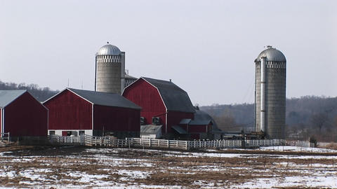 Long shot of well-kept classic American farm buildings in early winter Footage