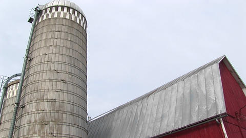 Worms-eye view of a farm silo and barn roof Stock Video Footage