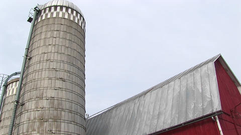 Worms-eye view of a farm silo and barn roof Footage