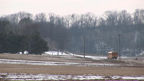 A bright yellow school bus stops to pick children up... Stock Video Footage
