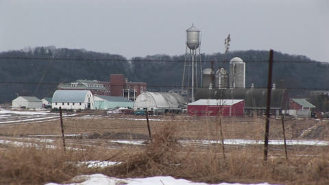 Long-shot of a small town with snow-covered fields Stock Video Footage
