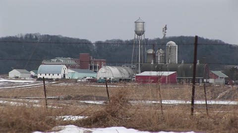 Long-shot of a small town with snow-covered fields Footage