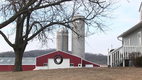 A farm complete with red barns, silos, and tire swing for... Stock Video Footage