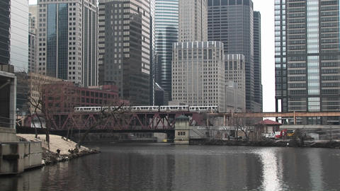 An attractive look at Chicago with modern skyscrapers in the background, elevated-trains and the riv Footage