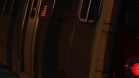 A subway train travels by the camera Stock Video Footage