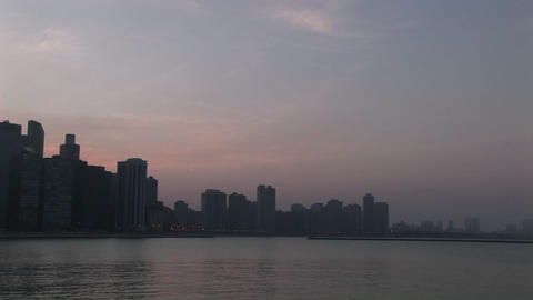 Slow pan-left across Chicago skyline during golden-hour... Stock Video Footage