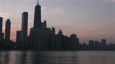 Slow pan-left across Chicago skyline during golden-hour from Lake Michigan Footage