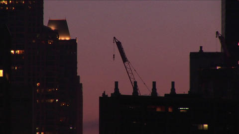 A building crane rests on a rooftop in a golden-hour... Stock Video Footage
