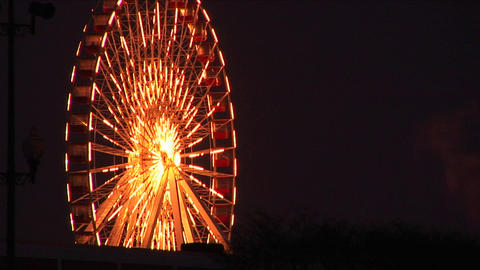 Eye-catching lighting on a ferries wheel is sure to catch attention of fair-goers Footage