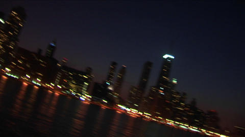 A sweeping angled view of Chicago at night from the lakefront Footage