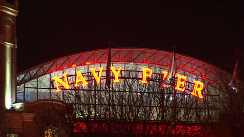 Camera zooms in on Chicago's famed Navy Pier at night Footage