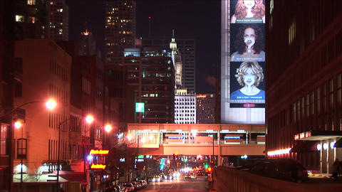 Downtown Chicago at night is illuminated with lights from many sources Footage