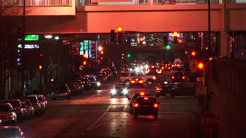 A busy downtown scene at night with congested traffic Stock Video Footage
