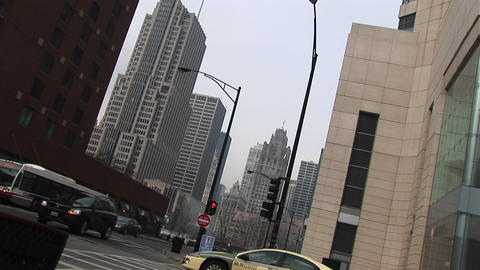 An angled shot of downtown buildings with moving traffic Footage
