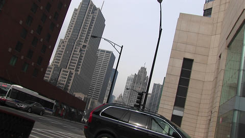 An angled shot of downtown buildings with moving traffic Stock Video Footage