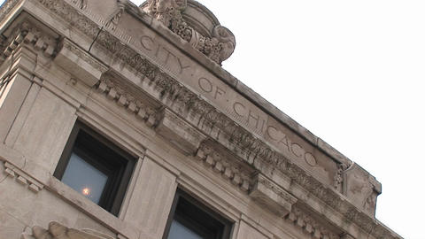 "An angled shot of a building facade includes the words, City of Chicago"" on it Footage"
