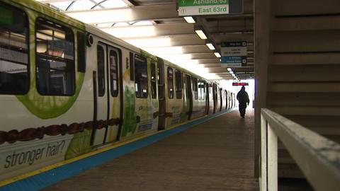 Passengers exit a colorful commuter train before it... Stock Video Footage