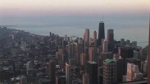 An bird's eye view of Chicago's downtown skyline and lakefront during the golden-hour Footage