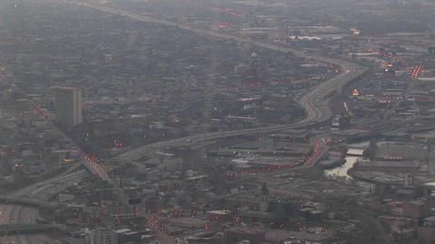 A aerial shot of a freeway and surrounding metropolitan area Stock Video Footage