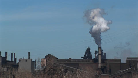 A small industrial plant spews out smoke Stock Video Footage