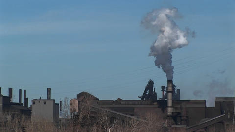 A small industrial plant spews out smoke Footage