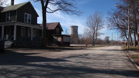 Residential homes are located near a nuclear power plant Stock Video Footage