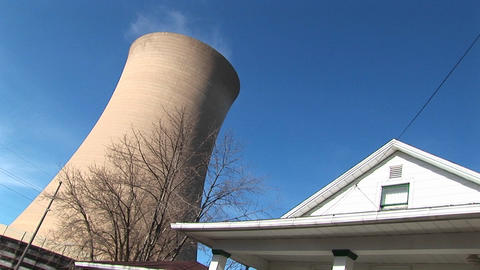 The gigantic cone of a nuclear reactor looms above the... Stock Video Footage