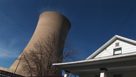 The roof of a residential home looks in close proximity to a nearby nuclear power plant Footage