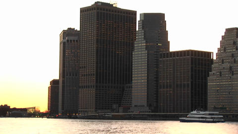 A tourist boat travels the New York waterfront in front... Stock Video Footage