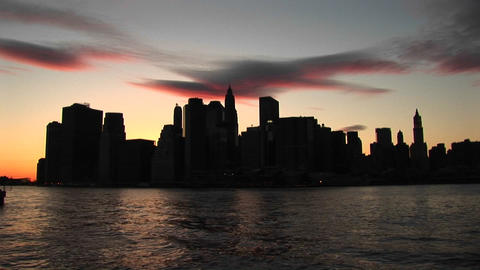 The river reflects the last rays of sunlight in this New... Stock Video Footage