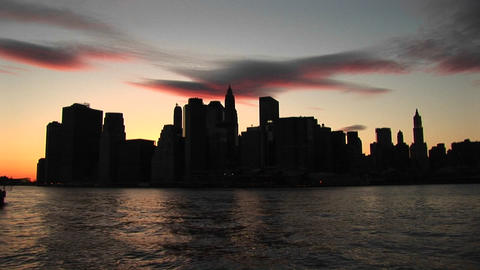 The river reflects the last rays of sunlight in this New York City skyline shot Footage