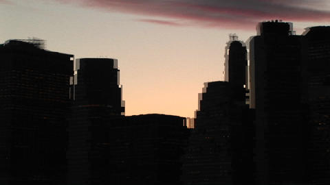 A pan of New York's skyline at golden-hour to the lights... Stock Video Footage