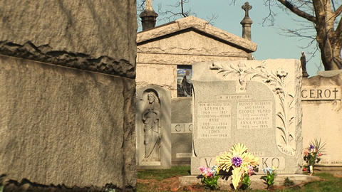 The camera pans through an old cemetery's tombstones and... Stock Video Footage