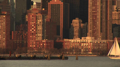 A sailboat heads toward the pier off downtown Manhattan Stock Video Footage