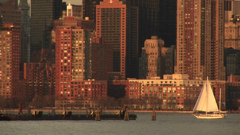 A sailboat heads toward the pier off downtown Manhattan Footage