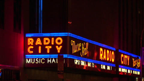 The camera pans up the neon illuminated Radio City Music... Stock Video Footage