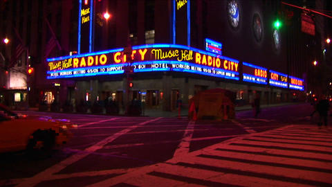Radio City Music Hall at night with lights, traffic and... Stock Video Footage