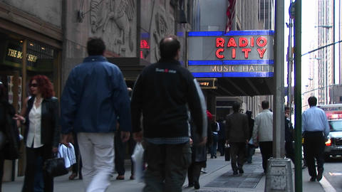 Medium-shot of people walking under the Radio City Music... Stock Video Footage