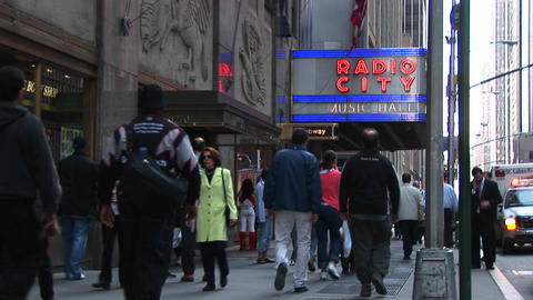 Medium-shot of people walking under the Radio City Music... Stock Video Footage