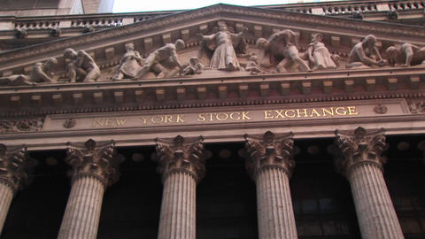 The camera pans up the columns of the New York Stock... Stock Video Footage