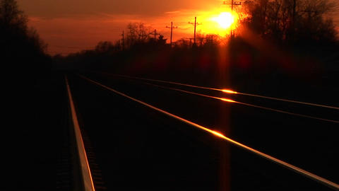 Railroad track glow in the golden-hour sunlight Stock Video Footage