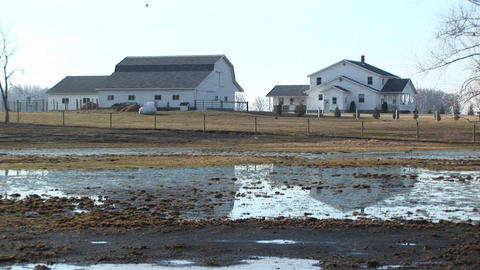 A farmhouse, barns and a winter thaw Stock Video Footage