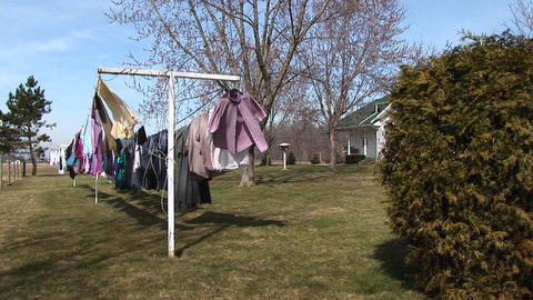 Clothes are hung on an outdoor clothesline to dry in the... Stock Video Footage