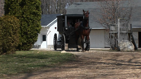 An Amish horse and buggy head out to the highway with... Stock Video Footage