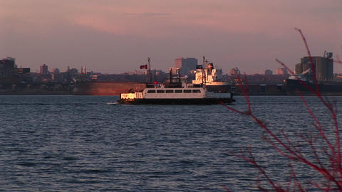 A Canadian passenger boat travels past a lake freighter... Stock Video Footage