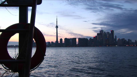 View from an island boat dock of the Toronto, Ontario, skyline during the golden-hour Footage