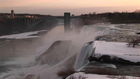 Niagara Falls in winter from the top looking toward the closest bridge Footage