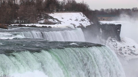 Water rushes over Niagara Falls in winter Stock Video Footage